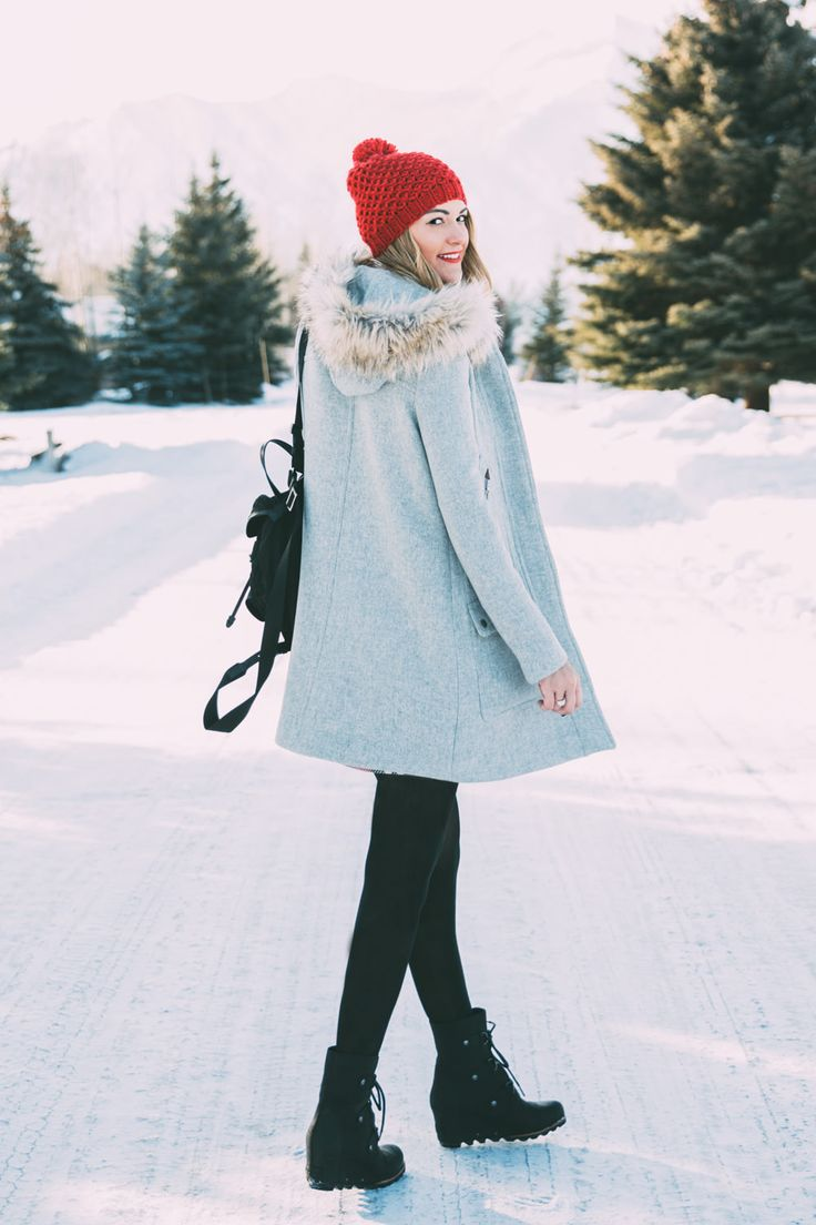 Caitlin Lindquist of the travel blog Dash of Darling shares a holiday winter outfit with Bronzallure in a Topshop plaid skirt, Club Monaco sweater and J.Crew fur hood coat.