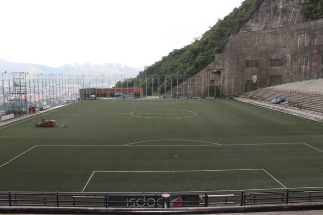 Cocodrilos Park - Venezuela  Sandwiched between a sheer rockface and a deathly drop to a busy motorway, Cocodrilos Park is a multi-purpose stadium that befits one of the title of one of the most unusual placements.