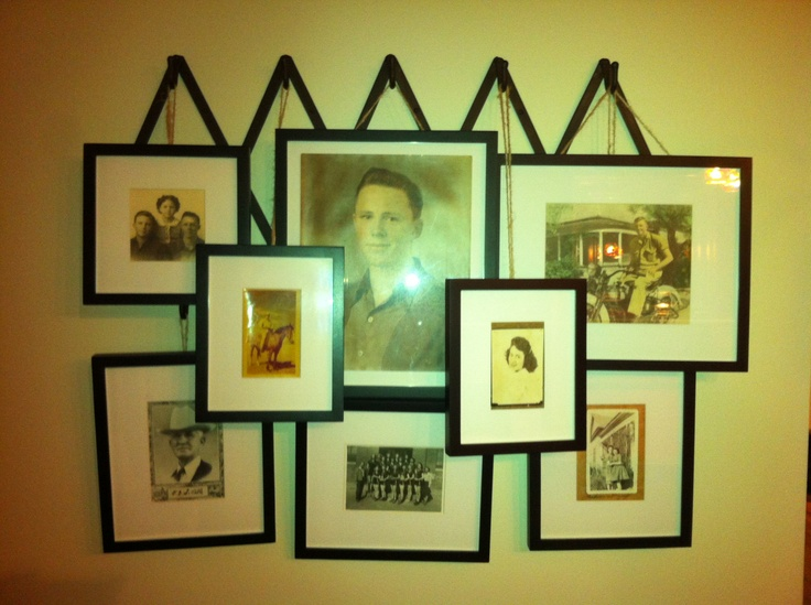 This was inspired by a display I saw at Pottery Barn.  The photos are hung on an accordion coat rack using jute.  These photos are really old photos of my family.  Love this!