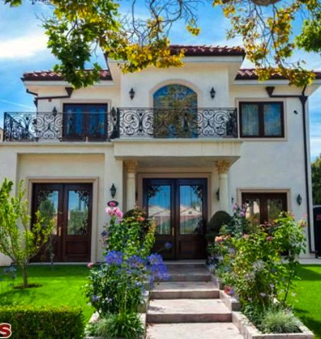 Spanish / French influence- would do the wrought iron all the way across the front. Beautiful!