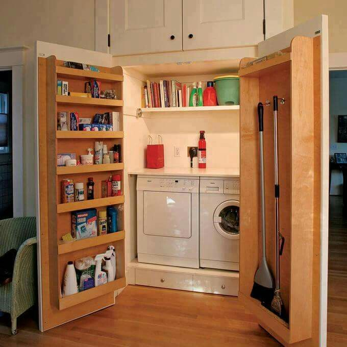 Large cabinets hiding laundry with extra functional doors for extra storage