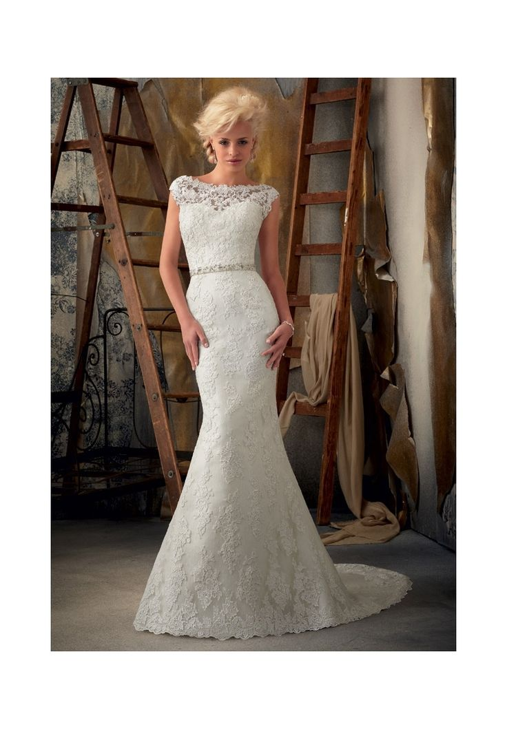 Wedding Dresses and Wedding Gowns by Morilee featuring 1901 Venice Lace Appliques on Net This elegant sheath gown, created from Venice lace appliques on Net, features a classic bateau neckline that continues to the V-shaped back. The waist is accented with a crystal and pearl removable tie sash. Belt also sold separately as Style #11009. Colors Available: White, Ivory. Sizes Available: 2-28. Available in three lengths: 55', 58', 61'.