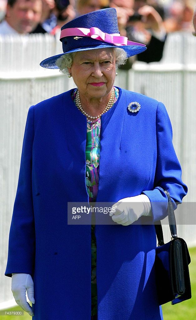 Queen Elizabeth II arrives for the second day of the annual Vodafone Derby horse…
