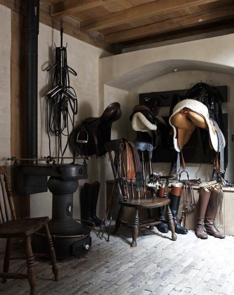 beautiful tack room in this rustic horse barn!