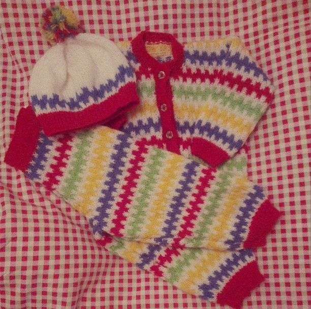 Full double knitting, knitted rainbow toddler set! Red, blue, green and yellow zig zag stripe set with cardigan, trousers and bobble hat.