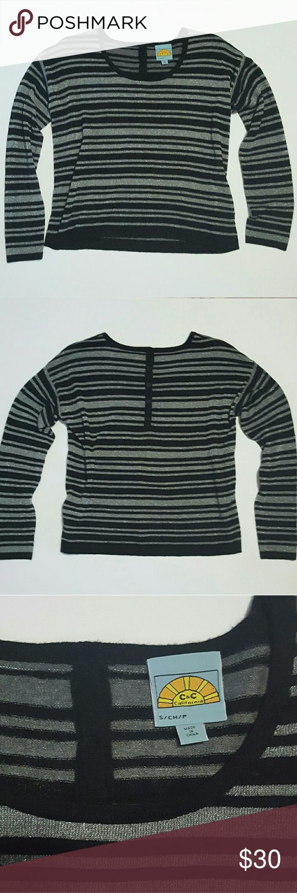 C&C California Black Silver Stripe Sweater Excellent condition! Worn once. Metallic silver thread detail and black stripes. 5 button detail at back.   32% nylon, 31% rayon, 21% wool, 9% polyester, 4% metallic, 3% cashmere.  Lightweight and soft and very pretty. Made to have a relaxed fit. C&C California Sweaters Crew & Scoop Necks