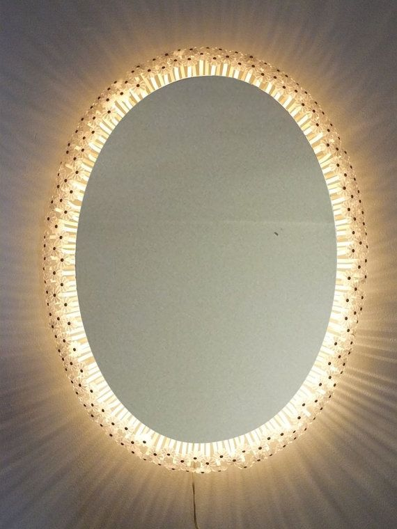 Emil Stejnar. Oval mirror with light or backlit by elNidosingular