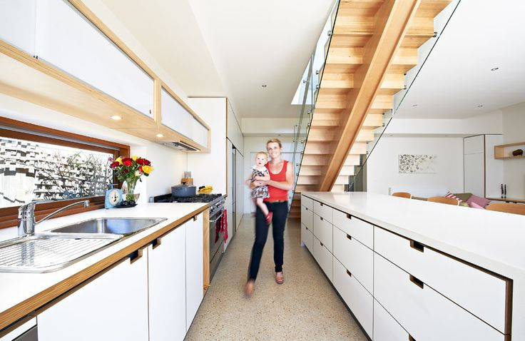 Integrating the Kitchen, Laundry and Living areas into a functional open plan hub unified the home of this young Yarraville family.