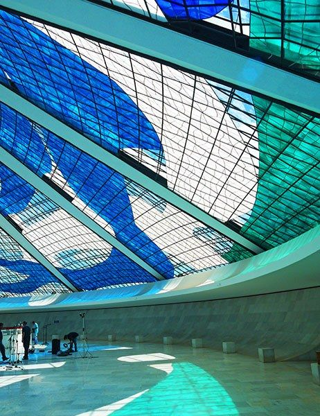 For his Cathedral of Brasília, completed in 1970, architect Oscar Niemeyer constructed a striking hyperboloid structure from 16 concrete columns. Years later, a 21,528-square-foot stained-glass work by Marianne Peretti replaced the clear glass that filled the negative space between the pillars, creating a swirling pattern of blues and greens visible from both inside and out.