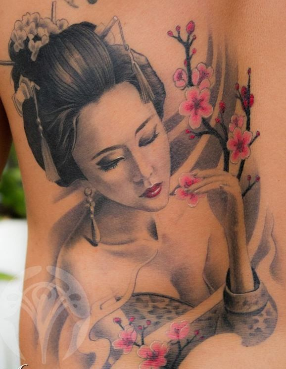 Lovely geisha with flower tattoo on back - Japanese Tattoos - Tattooimages.biz