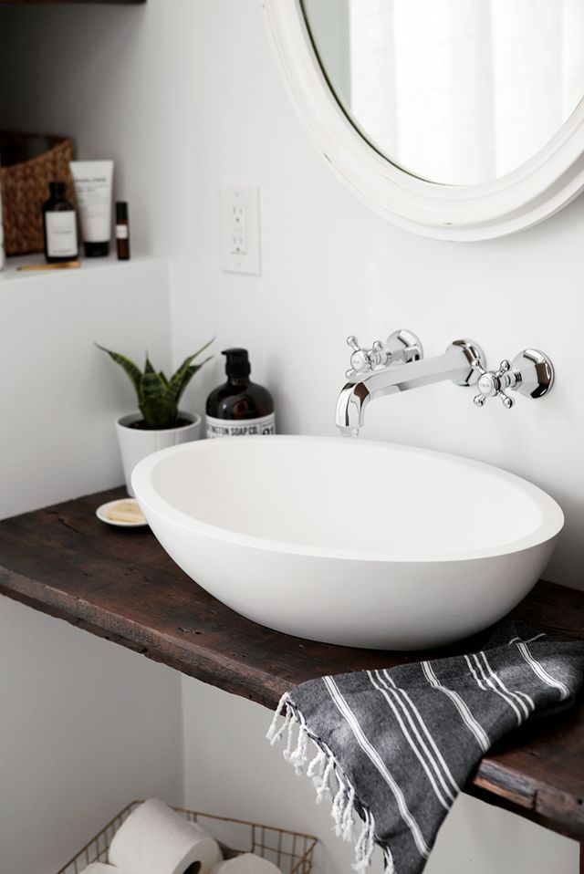 When we first started designing our bathroom, I was on the hunt for a vintage pedestal sink to go in here. I love the look of those and thought it would work well for the small space we had. Then, we