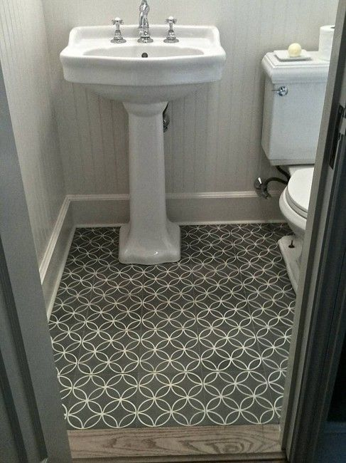 Gorgeous Bathroom With White Beadboard Walls And Charcoal Gray Interlocking Circles Floor Tile