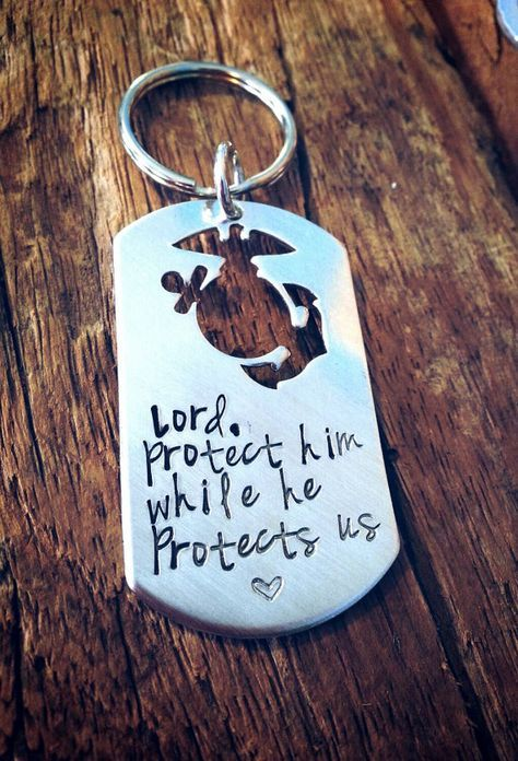 This is a dog tag style keychain with a perfect cutout of the marine emblem. The perfect gift as a reminder and prayer for your marine. The