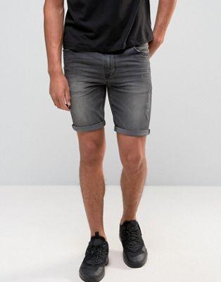 Черные джинсовые шорты скинни с прорехами ASOS