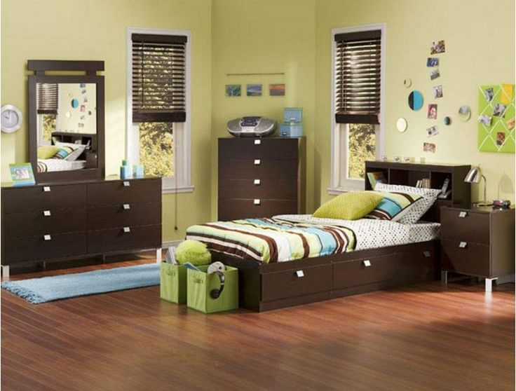boys bedroom with dark wood furniture and green and blue accents