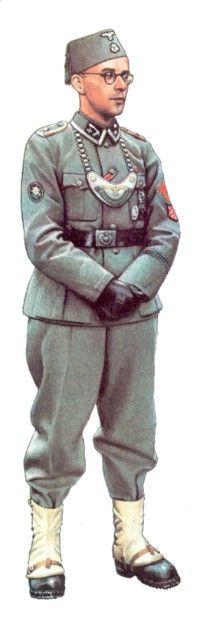 Lieutenant, 1941 Cet officier de chars, vétéran de la guerre civile espagnole, porte la tenue spéciale en drap noir réservée aux personnels servant dans les engins blindés entièrement clos. A la boutonnière apparaît le ruban de la Croix de fer de 2eme...