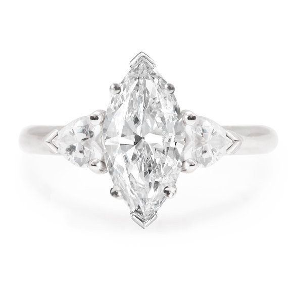 This eye-catching marquise moissanite ring: | 32 Insanely Sparkly Engagement Rings That Don't Use A Single Diamond