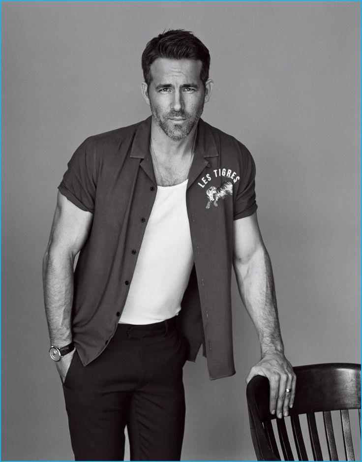 Going semi-casual, Ryan Reynolds wears a Topman shirt with a Calvin Klein tank, Louis Vuitton trousers, and a Piaget watch.