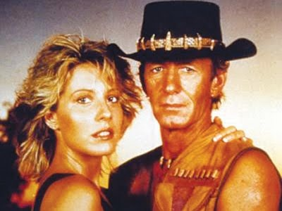 Crocodile Dundee is a 1986 Australian comedy film set in the Australian Outback and in New York City. It stars Paul Hogan as the weathered Mick Dundee and Linda Kozlowski as Sue Charlton. Inspired by the true life exploits of Rodney Ansell, the film was made on a budget of under 10$ million as a deliberate attempt to make a commercial Australian film that would appeal to a mainstream American audience, but proved to be a worldwide phenome