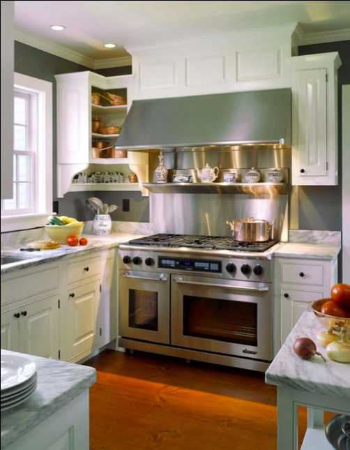 Marble stainless steel window white cabinets black for Quaint kitchen designs