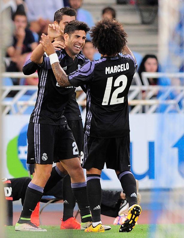 Marco Asensio is congratulated by Alvaro Morata and Marcelo