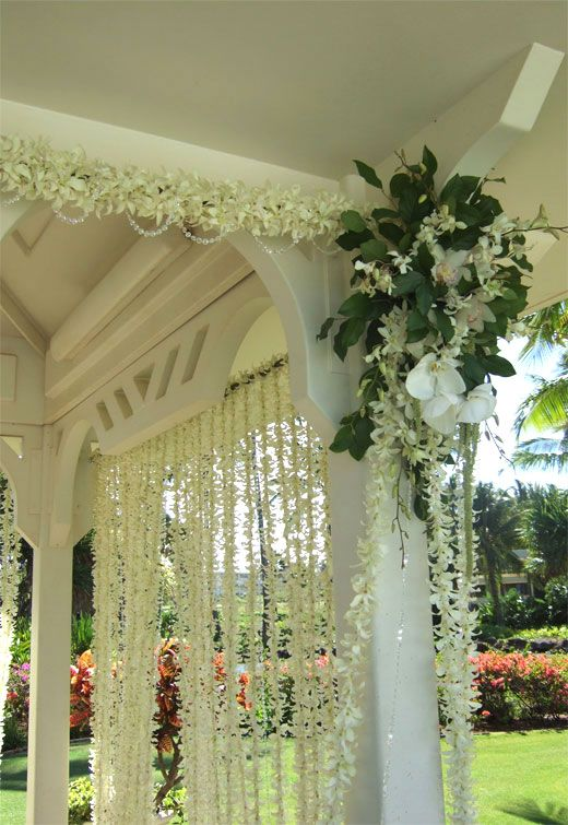 Gazebo strands of Dendrobium orchid leis, Phalaenopsis, and Cymbidium & Dendrobiums orchids used throughout gazebo