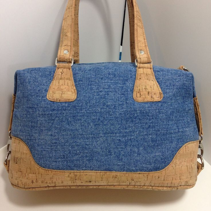 "Features: - Approx. 11"" W x 7"" L x 5"" D - Short handles and Shoulder/Crossbody strap - Cork Fabric is as durable as leather, feels soft in the hand - Inside zipper pocket - Tassel ** photos of actual"