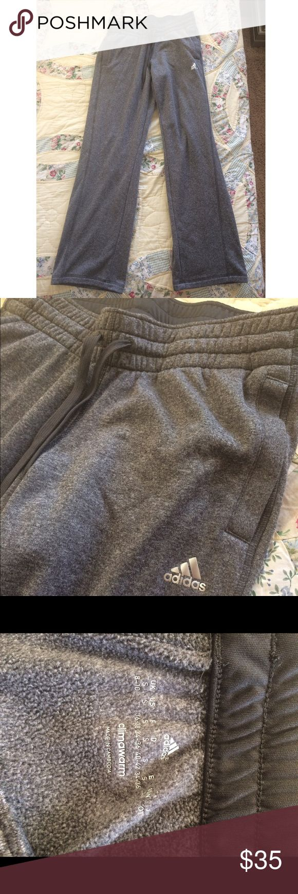 Adidas Climawarm sweatpants in dark grey Grey loose fitting sweatpants. They are for women and have two front pockets and a drawstring. Super soft and comfortable, worn twice but they are just too small for me:) Adidas Pants Track Pants & Joggers