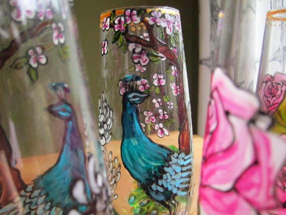 Hand painted gilded peacock and rose champagne flutes via Etsy