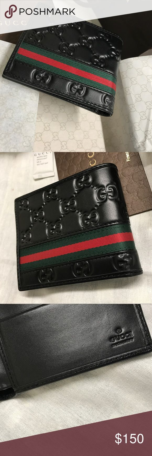 "Authentic Gucci signature web men's wallet This bi-fold wallet is made in heat debossed Gucci Signature with Gucci Web stripe detail.  Hand-painted edges Black Gucci Signature leather, heat debossed for a defined print and firm texture, with black leather trims Green and red Web Three card slots and two bill compartments Open: 8.5""W x 3.5""H Closed: 4.5""W x 3.5""H x .5""D Any questions please email me at Thebeltguy1@gmail.com Gucci Accessories Money Clips"