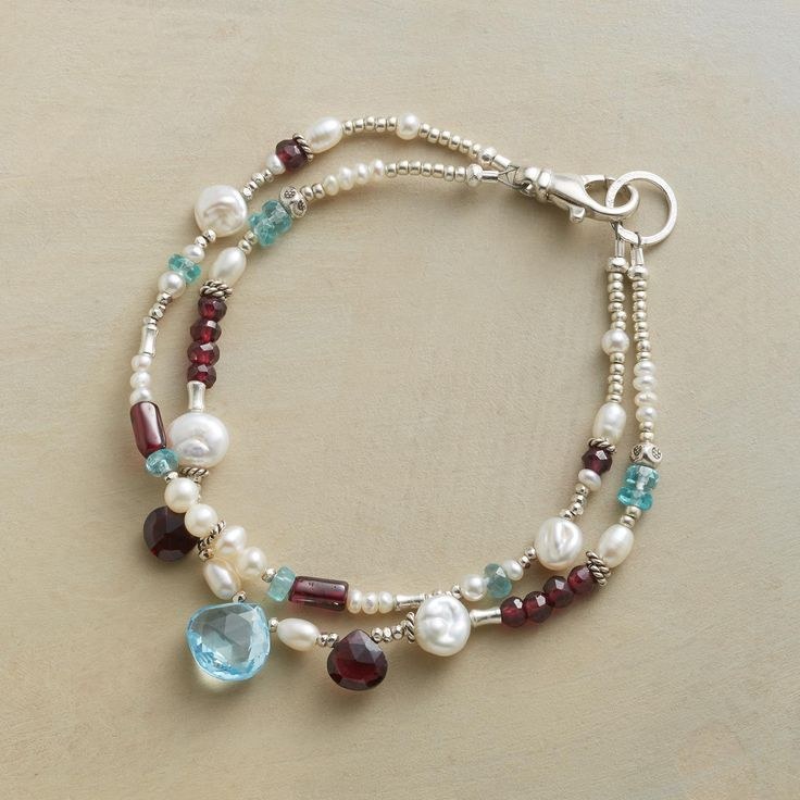 "Embers & Ice Bracelet - The passionate glow of red garnet and the frosty cool of sterling silver, apatite and pearls join a glittering faceted blue topaz in a handcrafted gemstone embers and ice bracelet that makes the event. USA. Exclusive. 7-1/2""L."