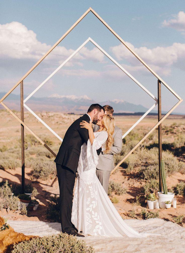 Weddingchella Desert Wedding // Geometric diamond design backdrop for this festival hipster inspired wedding