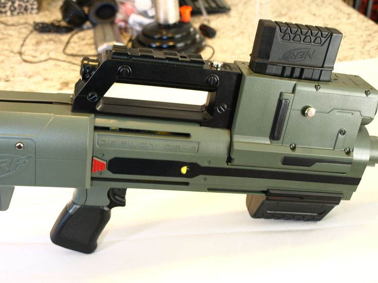 Custom Modded NERF DEPLOY CS-6. Includes working LED light and custom painted army satin green and black satin.