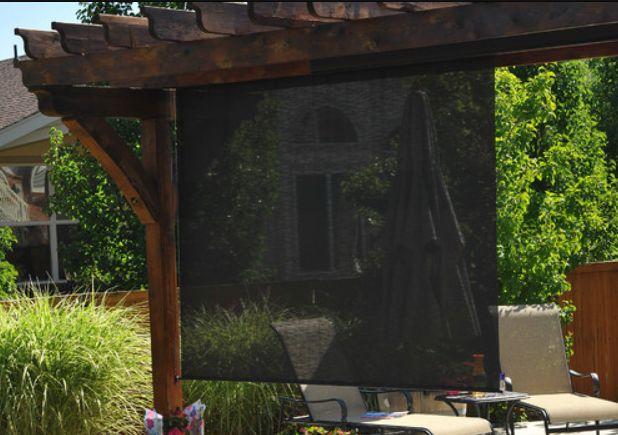 Exterior: Solar Shade Screen On Side Of Pergola