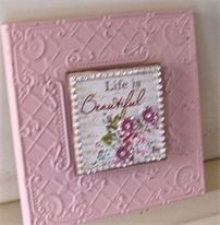 """""""Life is Beautiful"""" Inspirational Wall Plaque. 20cm x 20cm. Embellished with pink crystal flowers and a diamante border. $18.00."""