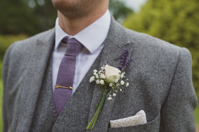 Grey tweed groom suit. White rose and lavender button hole. St Augustine's Priory Bilsington Ashford. Kent Wedding Photographer. Rebecca Douglas Photography - www.rebeccadouglas.co.uk