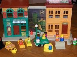 Sesame Street Playhouse. Had chalkboard inside. Love : )