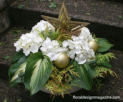 White  #floral  #arrangement #centrepiece  www.floraldesignmagazine.com/Christmas annuals.html #Christmas #holidayflowers #Xmas #floraldecor