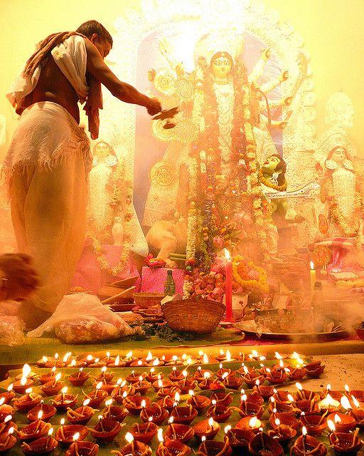 Priest offering prayers to the Goddess Durga - Kolkata, India