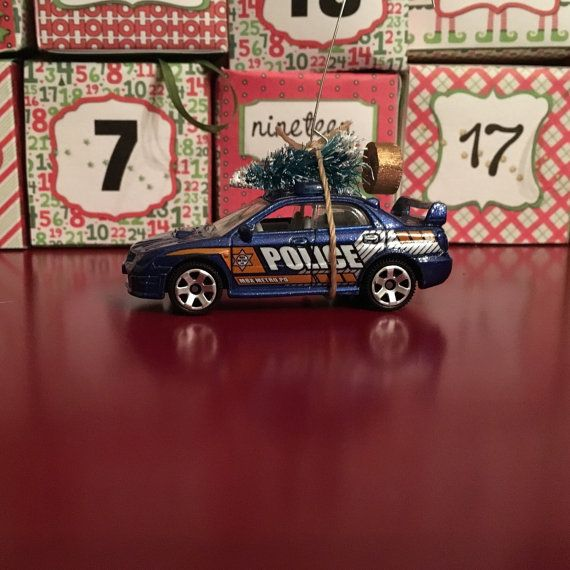 Police Car Carrying Christmas Tree Ornament by juniperjade on Etsy