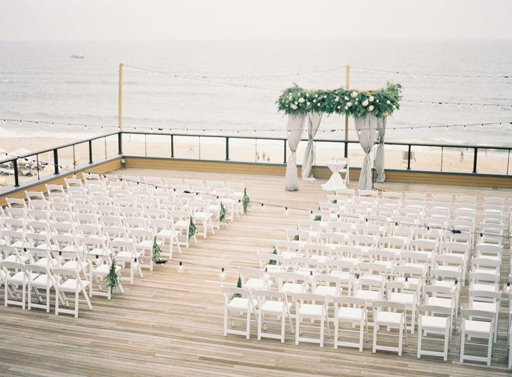 Photography : James A. of Judy Pak Photography   Wedding Venue : Gurneys Montauk Resort and Seawater Spa Read More on SMP: http://www.stylemepretty.com/little-black-book-blog/2017/02/20/modern-chic-al-fresco-hamptons-wedding/