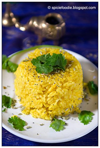 Indian; Cuisine; food; turmeric; rice; cilantro; fennel seeds; poppy seeds; black mustard seed; long grain rice; basmati rice; yellow; green; white; blue; plate; verticle; still life; healthy; coriander; curcuma