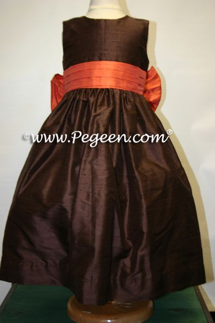 Orange and chocolate brown silk flower girl dresses - one of our favorite Halloween weddings for a fun Halloween-Themed event. Dress available from infants through plus sizes in 200+ colors of silk.