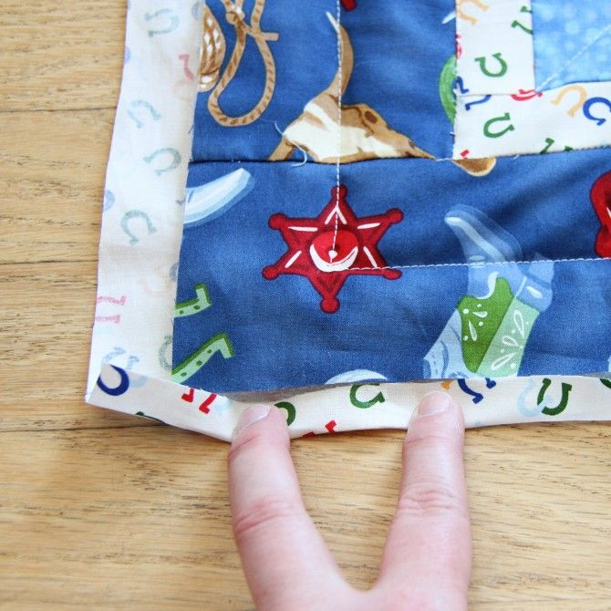 binding a quilt using backing fabric