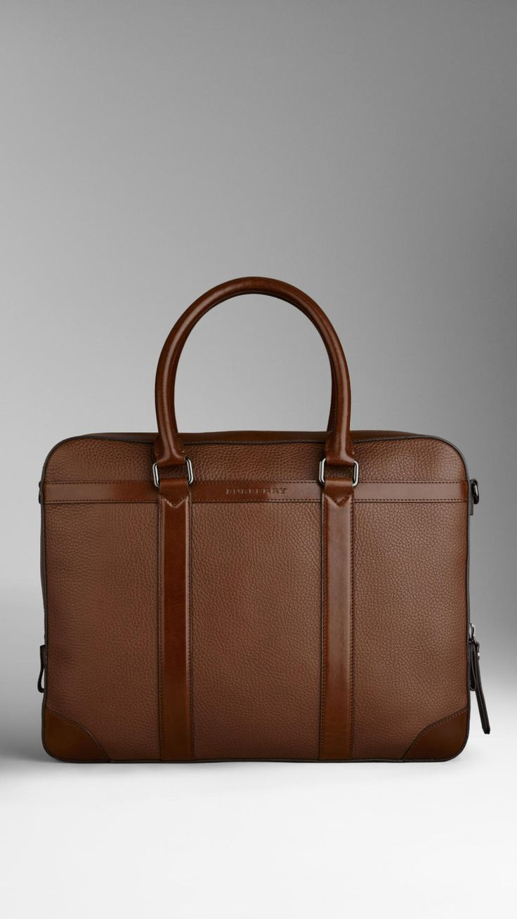 Grainy Leather Briefcase | Burberry $1,695.00 Item 38735191 MUSHROOM         Sartorial briefcase in rich grainy leather with smooth leather trim         Top zip closure, rolled leather handles and detachable webbed canvas crossbody strap         Interior pocket document compartment         Polished metal hardware         39 x 30 x 8cm         15.4 x 11.8 x 3.1in         100% calf leather         Imported