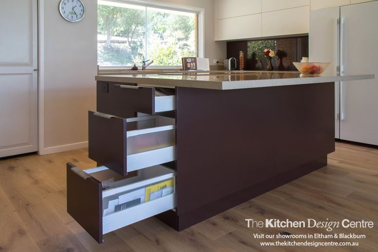 A large, modern kitchen with flush appliances, handle-less features and stunning island. www.thekitchendesigncentre.com.au @thekitchen_designcentre