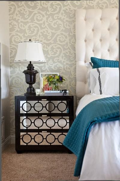 Gorgeous turquoise blue & espresso brown bedroom design with gray & ivory wallpaper, espresso brown mirrored nightstand chest, glossy black lamp, custom, tall, white, headboard and turquoise blue throw and pillows. #bedroom #nightstand #bedside #vignette