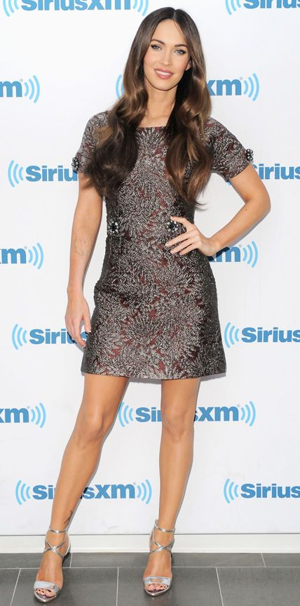 Megan Fox struck a fierce pose in a rich embellished jacquard Dolce & Gabbana dress, complete with metallic silver Brian Atwood sandals.