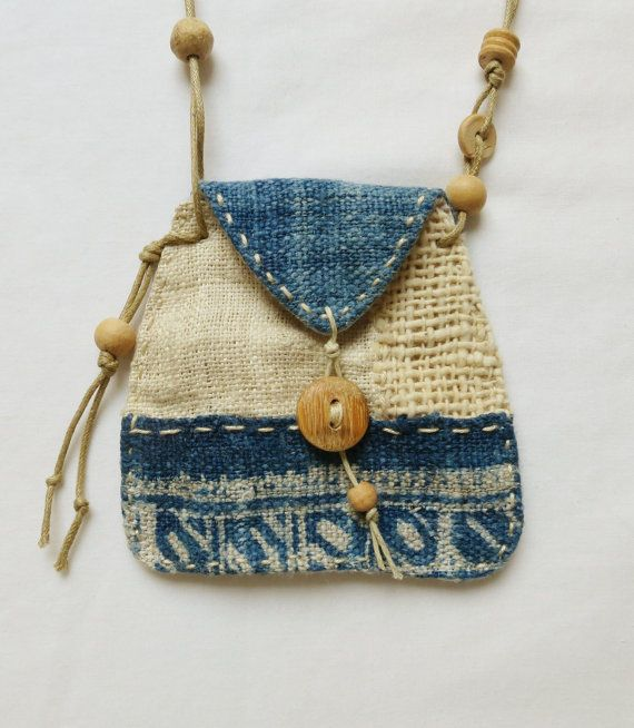 A beautiful patchwork talisman pouch, made using hand woven, indigo dyed hemp, indian cotton and natural linen. It has hand stitched details around the