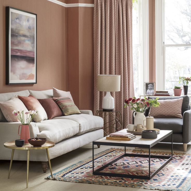Coral living room with neutral sofa